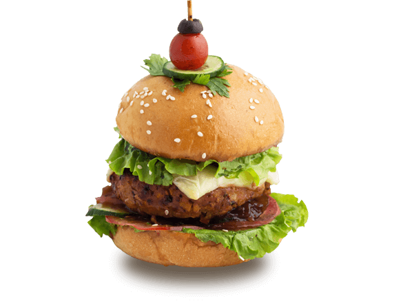 Chicken Burger - Chicken Patty, Vegetable Bouillon, Caramelized Onions, Lettuce, Tomato, Cheese, Olives and Jalapenos, Aioli, Burger Bun
